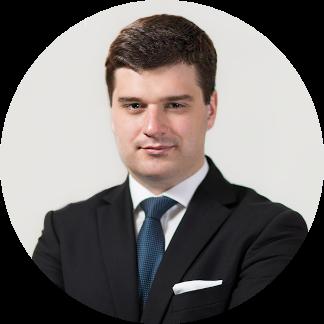 Zdjęcie portretowe przedstawiające radce prawnego Tomasza Kocoła